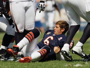 """No, guys. I'll just sit here until you figure out how to keep me from getting tackled. Thanks."""